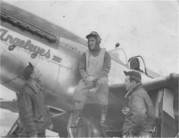 Capt. Howard E Wiggins sat on the wing of Mustang P-51D 44-15094 QI-A 'Angeleyes III', named after his school sweetheart and subsequent wife Edith Wiggins (Rowe). (With kind permission David Wiggins care of Peter Randall www.littlefriends.co.uk)