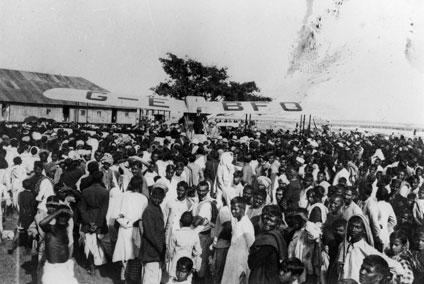 Alan Cobham in his de Havilland D.H.50 surrounded by crowds.