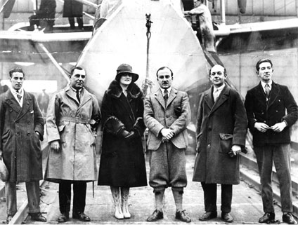 (From left to right) C E Conway, Captain H V Worrall, Lady Cobham, Sir Alan Cobham, F Green and S R Bonnett standing in front of a Short Singapore flying boat at the beginning of their Round Africa flight