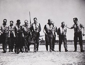 Pilots of the 310 (Czechoslovak) Squadron. Martlesham Heat airbase. (From right):  Piloti 310. cs. stíhací perute. Letište Martlesham Heat. Zprava: Jindrich SKIRKA, Miroslav JIROUDEK, Miroslav KREDBA (KIA, 14. února 1942/14th February 1942), František WEBER, Patrick B. G. DAVIES, Vladislav CHOCHOLÍN (MIA, 24. zárí 1943/24th September 1943), Bohuslav KIMLICKA, Josef HÝBLER, Stanislav ZIMPRICH (KIA, 12. dubna 1942/12th April 1942). Military History Archive. Vojenský historický archiv.