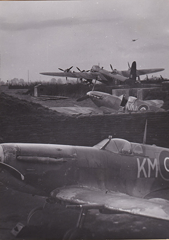 Aircrafts of the RAF. Short Stirling of an unknown British squadron, a Spitfire of the 310 (Czechoslovak) Squadron and in the foreground, the personal plane of W/Cdr Karel MRÁZEK, commander of the Exeter wing. Military History Archive.