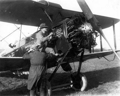 Engineer Arthur Elliott starting the de Havilland D.H.50J biplane