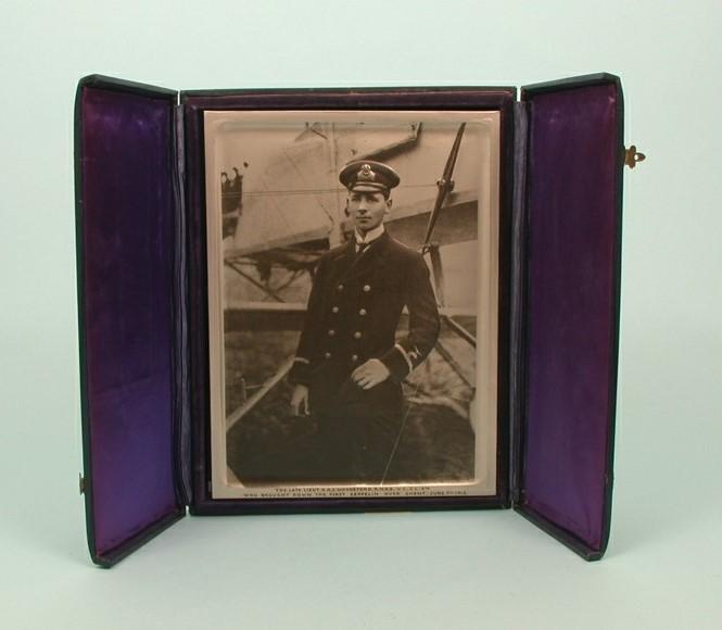 man in uniform in framed portrait in case