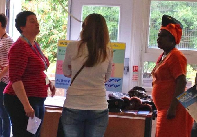 Volunteers talking to visitors