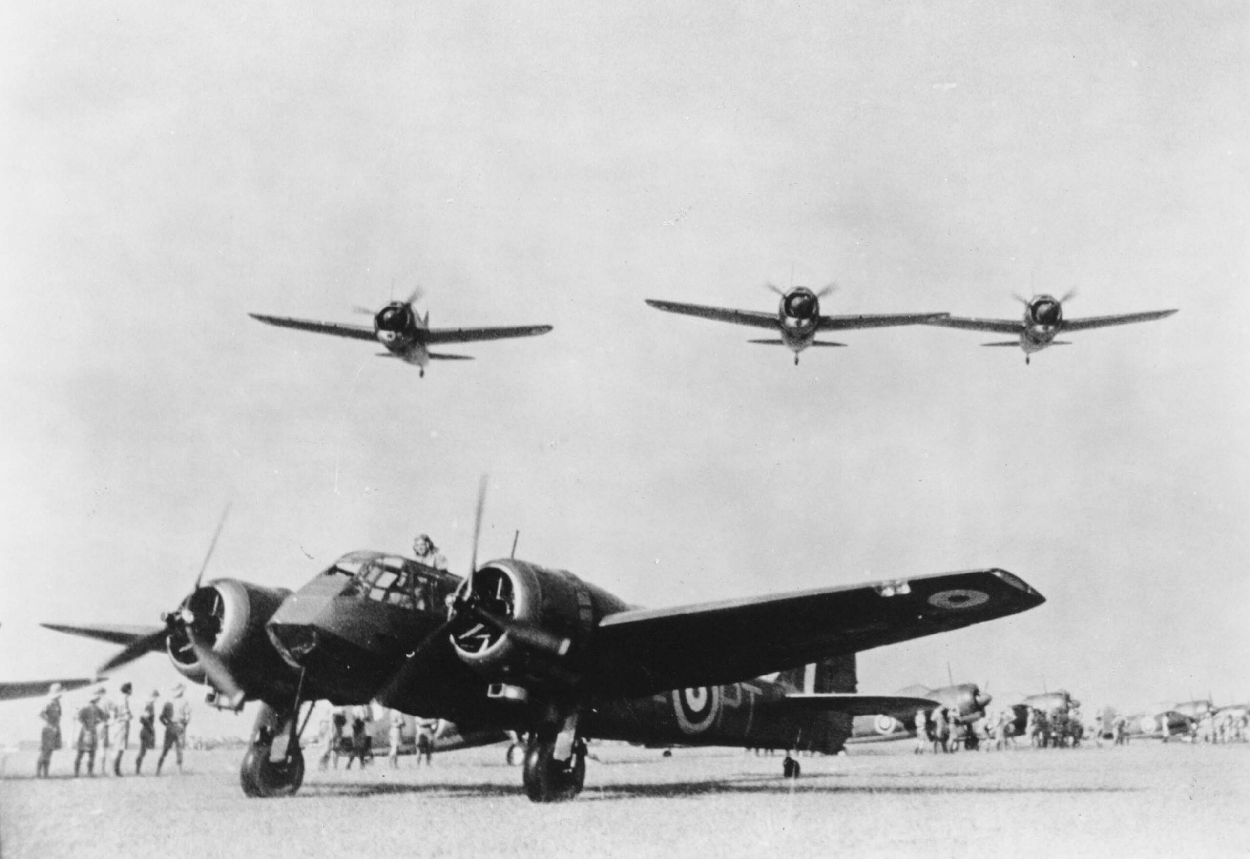 Three Brewster Buffalos fly over a No. 62 Squadron Bristol Blenheim at RAF Tengah, circa 1941 (RAFM X003-2674/1448)