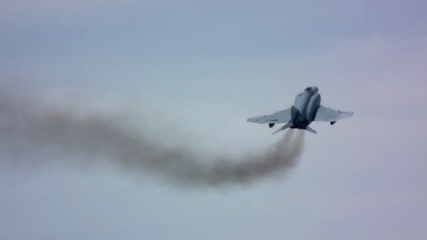 Image of a jet giving off polution. Image courtesy of Flightlineweekly.com