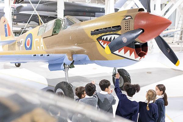 School Children looking at our Kittyhawk in Hangar 5