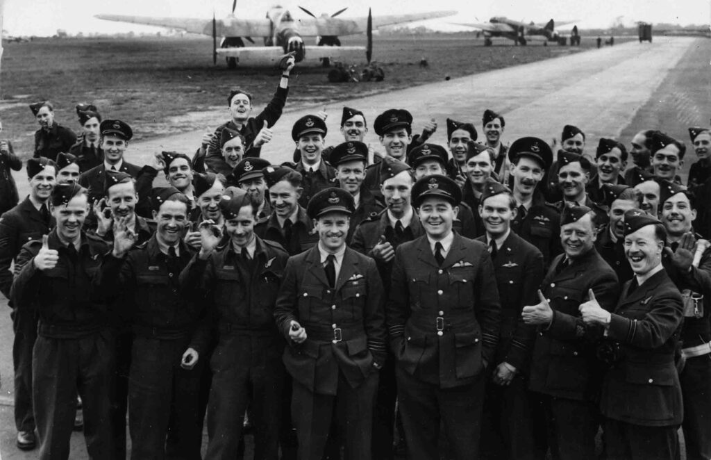 Wing Commander Guy Gibson and a group of aircrew of No. 106 Squadron, with Avro Manchesters in the background