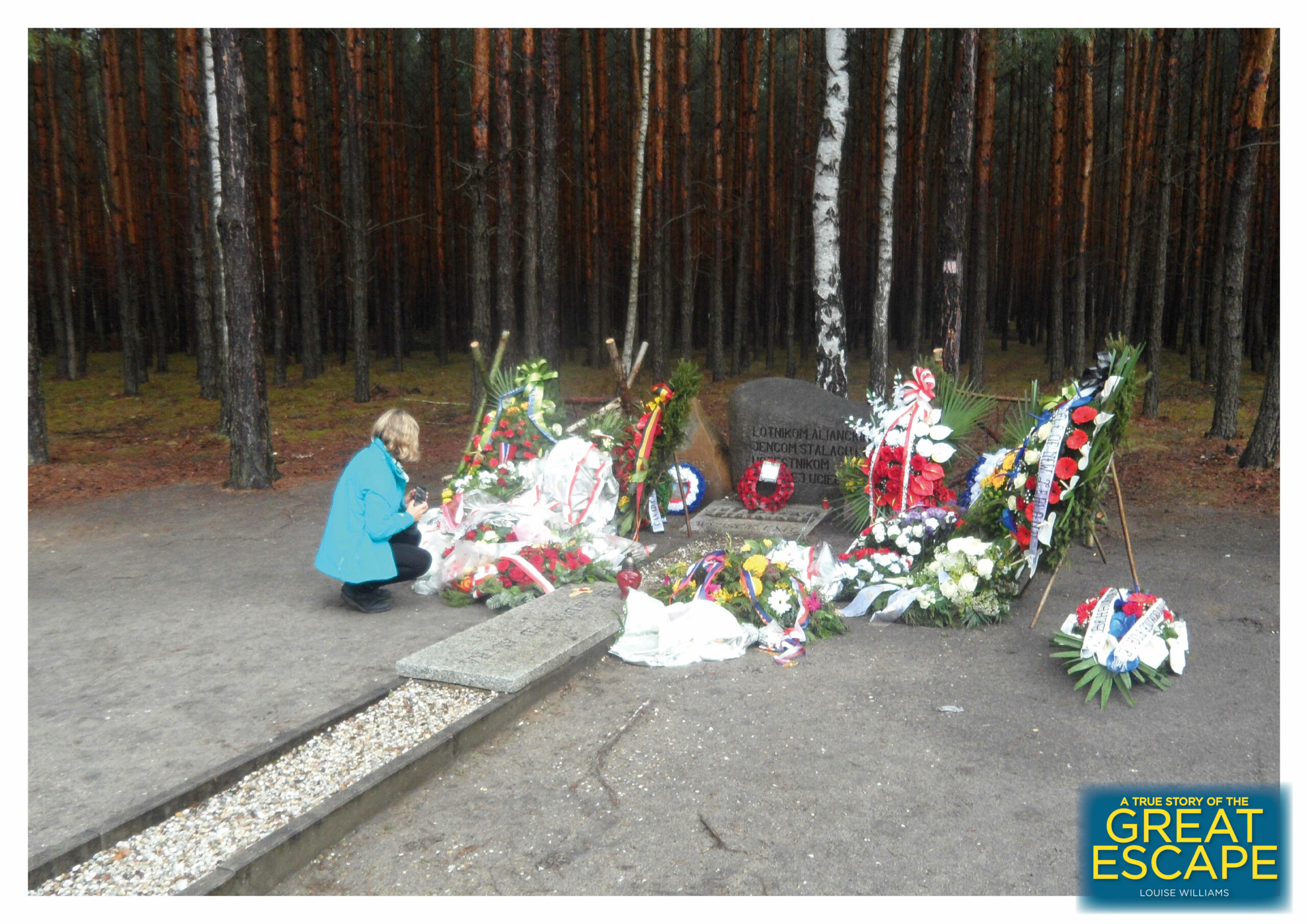 Floral tributes placed around a memorial