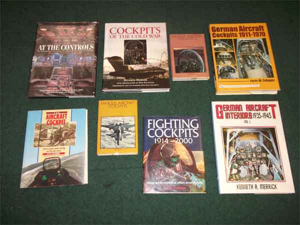 Some of the books in the Museum's Library illustrating historic aircraft cockpits.