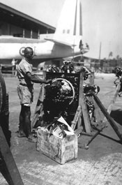 Member of the West African Air Corps working on an aero engine, Gambia, circa 1944 (X002-9326)