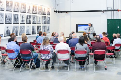 Members of the local community attending a free talk in Hangar 2