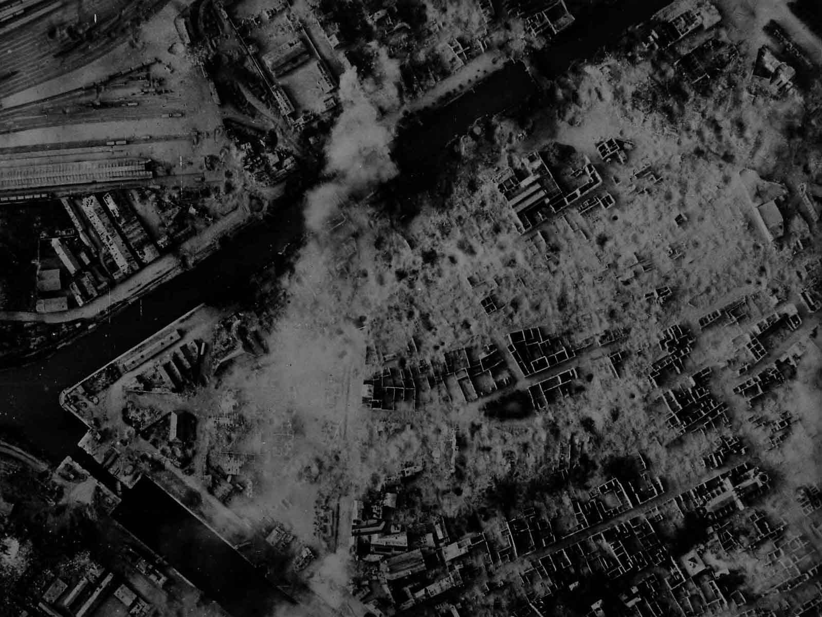 Vertical aerial photograph of Caen, c. June 1944. Railway lines visibile in top left corner.