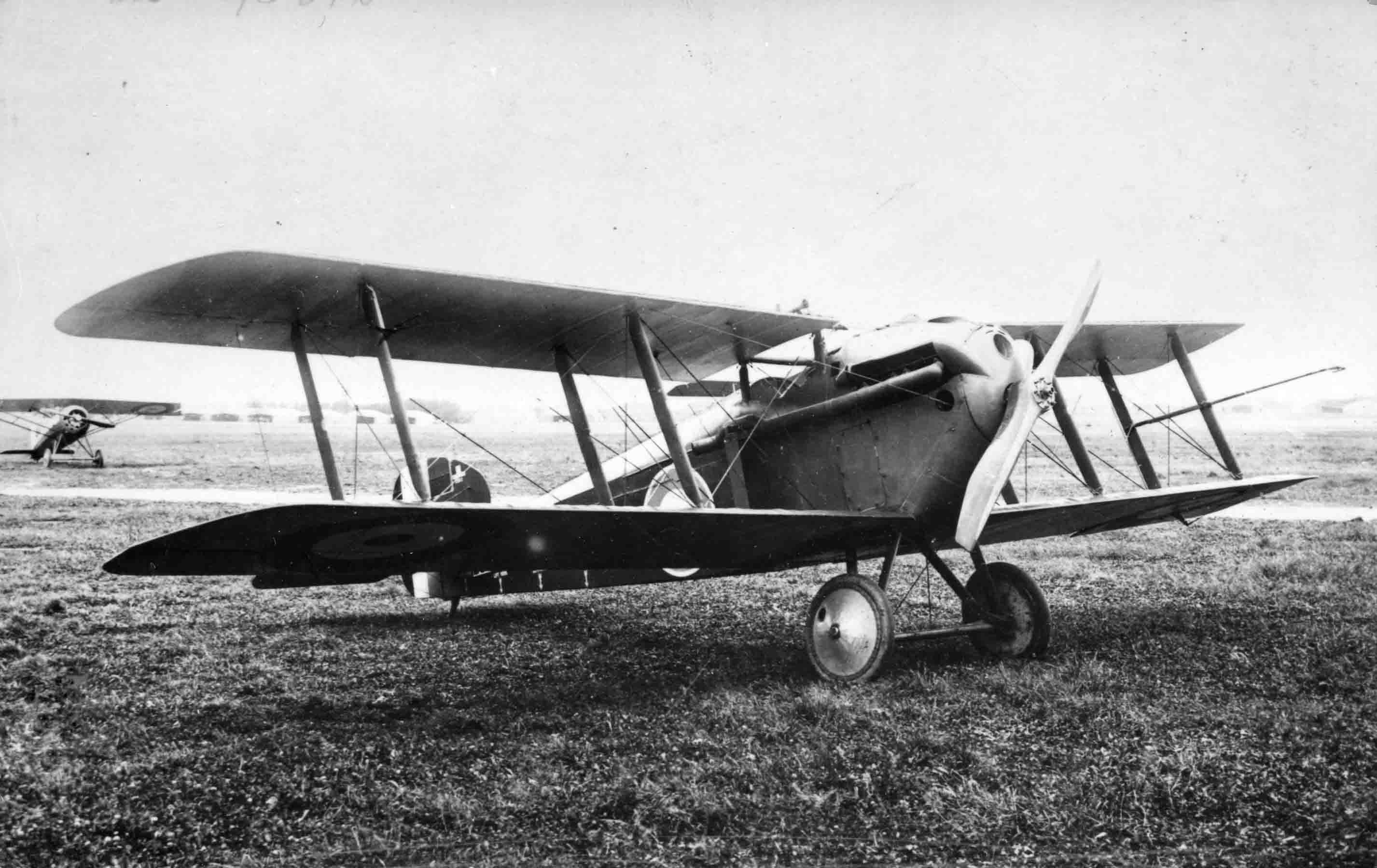 X003-2602-16119: Sopwith 5F.1 Dolphin II, serial D3615, Villacoublay, 1918.  This aircraft was transferred to the French government and was fitted with the 300hp Hispano-Suiza engine.  An air speed indicator was attached to the port outer interplane struts.  A Morane-Saulnier AI can be seen in the background.