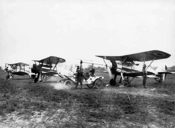 Sopwith 7F.1 Snipe Dual-Control Type with Armstrong Whitworth Siskin Mk.III DC, serial J7549 and Siskin Mk.III, serial J7764, in foreground with a Hucks starter.  The Siskins bear the squadron marking of 41 Squadron or 111 Squadron, with which both served.  All three aircraft were possibly photographed while at the Central Flying School, RAF.