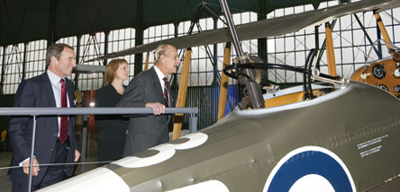 The Duke of Edinburgh looking into the cockpit of the Royal Aircraft Factory RE8