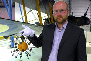 Museum Aviation Historian Ross Mahoney with a First World War anti incendiary device