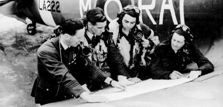 Airmen of the Second World War reading a map.