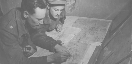 Airmen reading a map.
