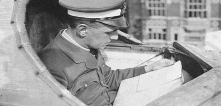 An airman reading a map.