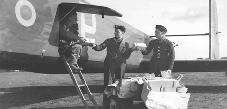 Propaganda leaflets being loaded into a RAF aircraft.