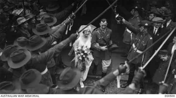 Lieutenant Frank Colin Craig RAF and Mrs Nancy Craig, daughter of General Sir William Birdwood, leaving Brompton Parish Church, after their wedding, through a guard of honour, 1919. (AWM D00500)