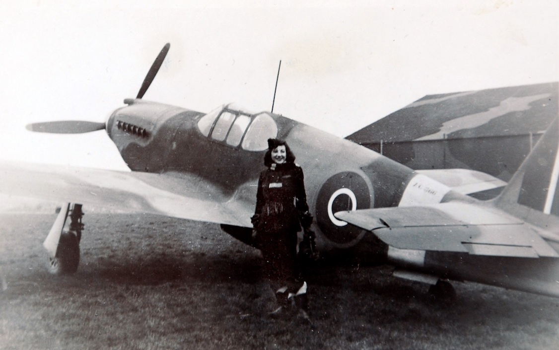 Jackie Moggride posing with her airplane
