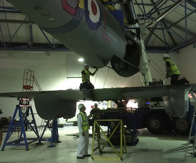 Gently lowering the Mosquito's fuselage onto its wings