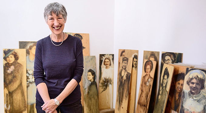 Bev Tosh with war brides' portraits