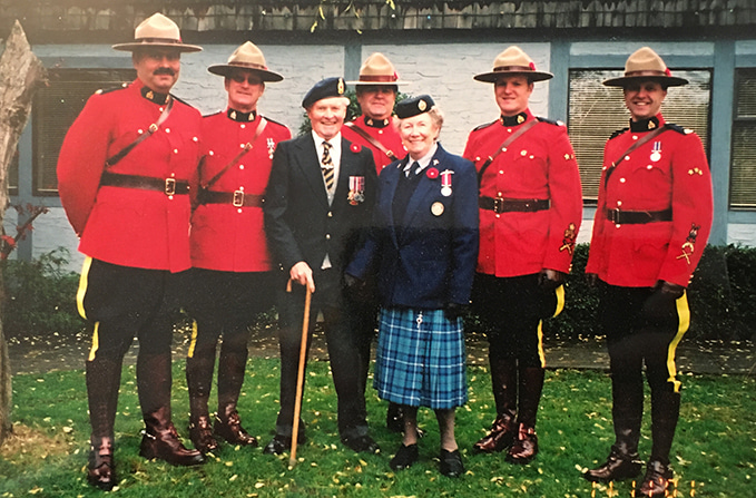 Eileen and Jimmie (Ernie) Little in Lantzville BC with the Mounties on Remembrance Day in 2001