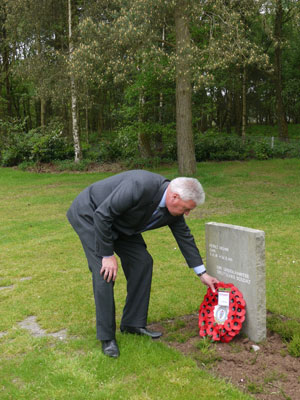 Alex Medhurst lays a wreath at the grave of Cpl Heinz Huhn at Cannock Chase Cemetery