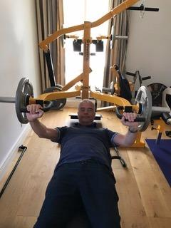 Another picture of Alan training on a bench-press in his home gym