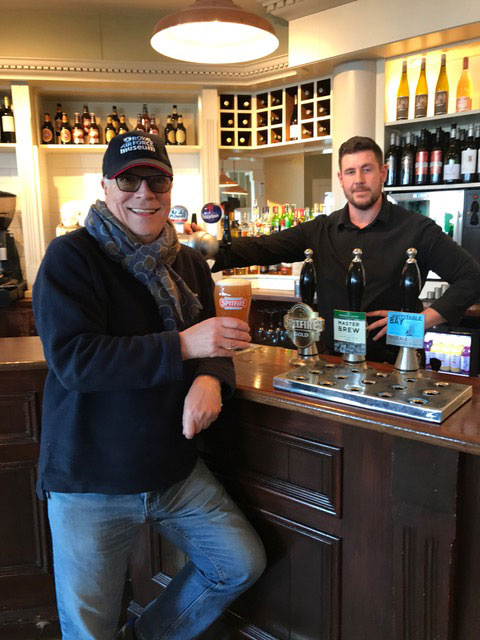 Alan enjoying a pint of Spitfire Ale expertly poured by Craig in Shepherd and Neame's Royal Hotel, Deal in Kent.