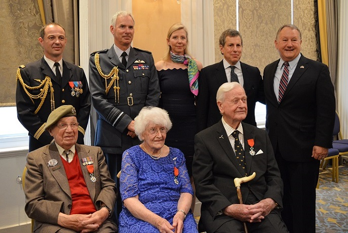 Veteran's pose for photos after being presented with their awards
