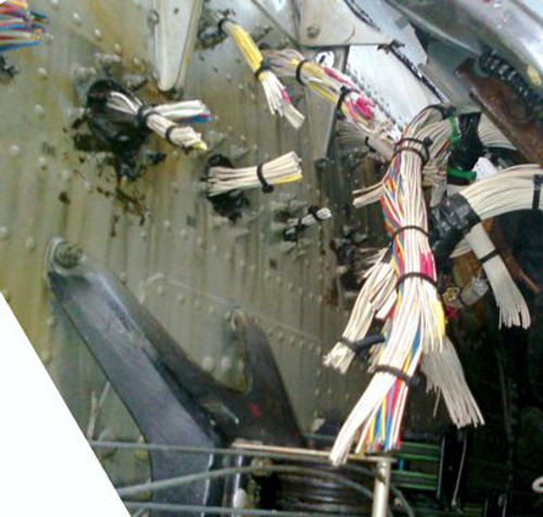 Bundles of cut wires at the wing root of XV249