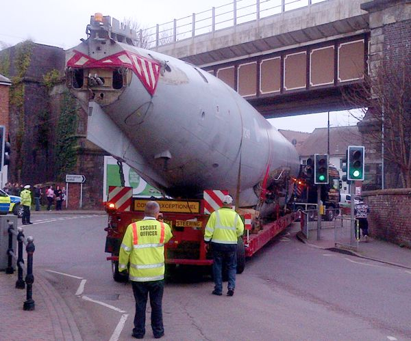 Nimrod fuselage negotiating railway bridge in Shifnal town centre