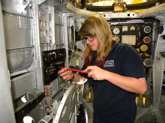Apprentice Ella Middleton working on the Handley Page Hampden