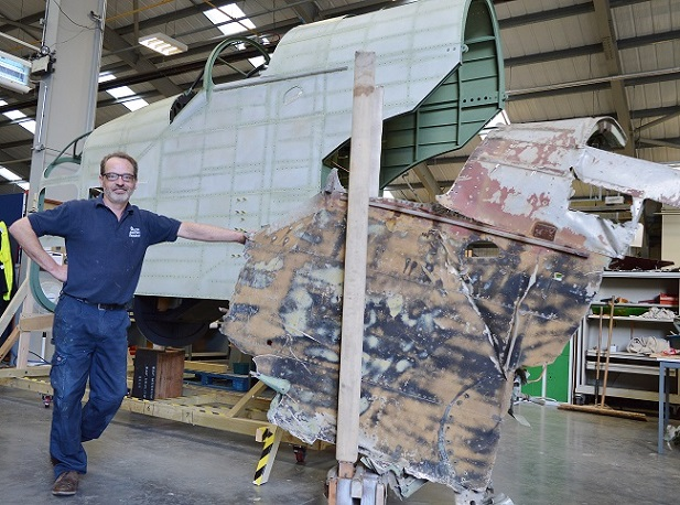 Aircraft Technician Dave Car with the newly built Hampden forward fuselage next to the original section from P1344