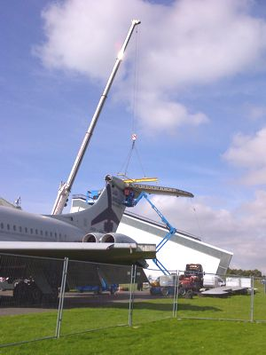 Tailplane being lifted into place by a crane