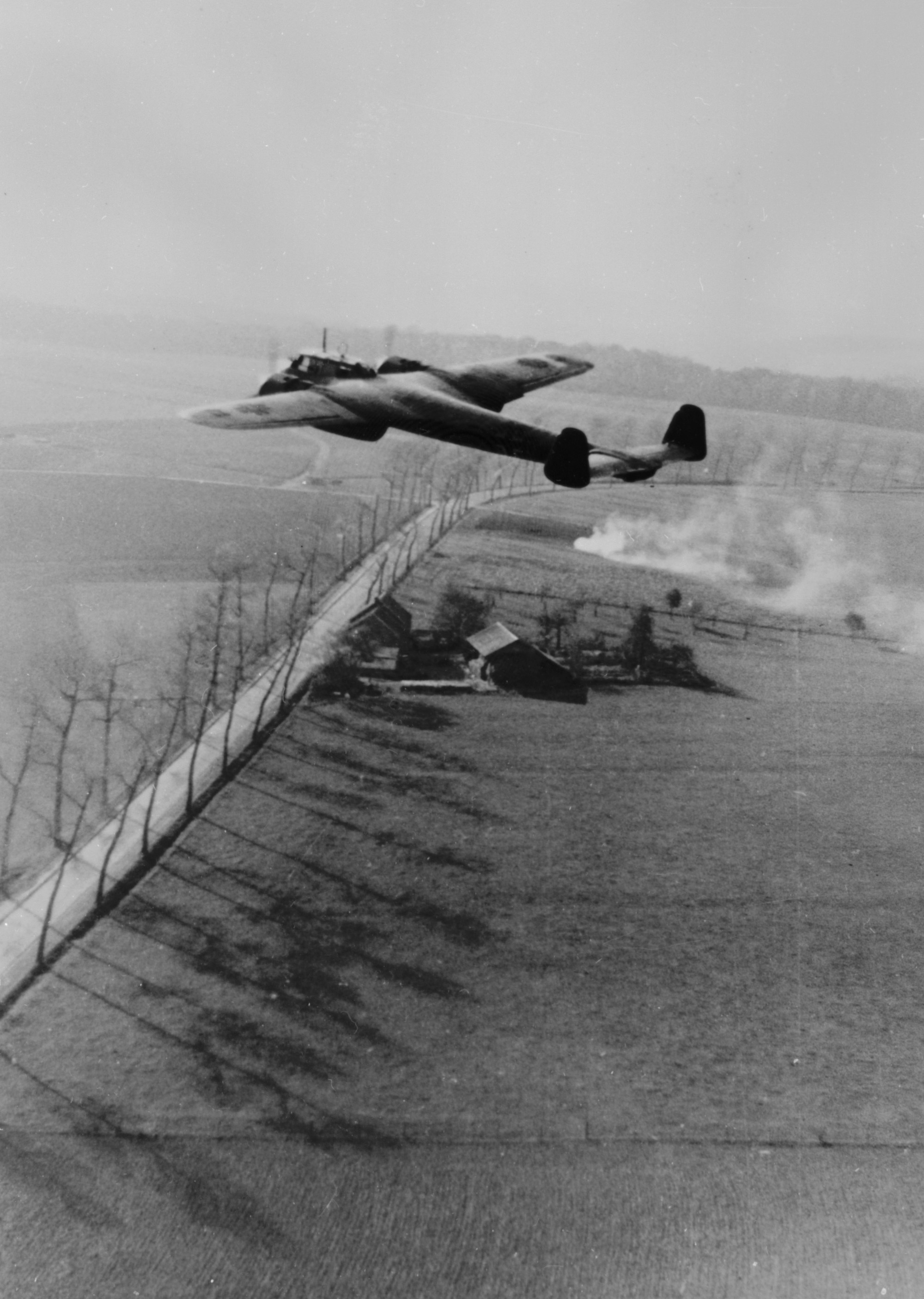 A Dornier 17Z of the Luftwaffe flying low over the English countryside (RAF Museum Copyright)