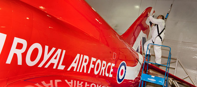 One of Cranwell's Highly skilled technicians putting the Names on Red Arrows Hawk XX322