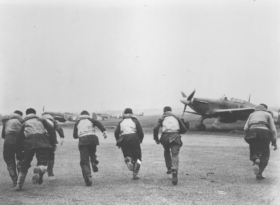 Pilots scrambling towards their aircraft.
