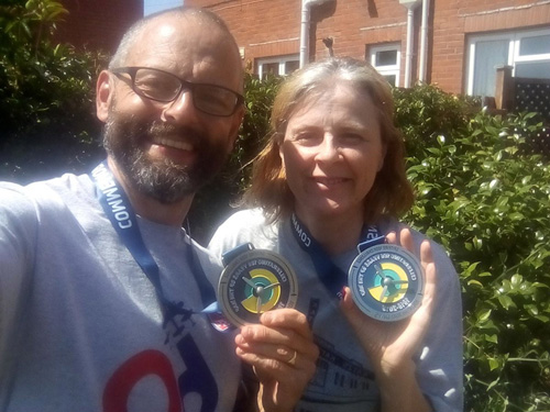 Participants of the Spitfire100k with their medals