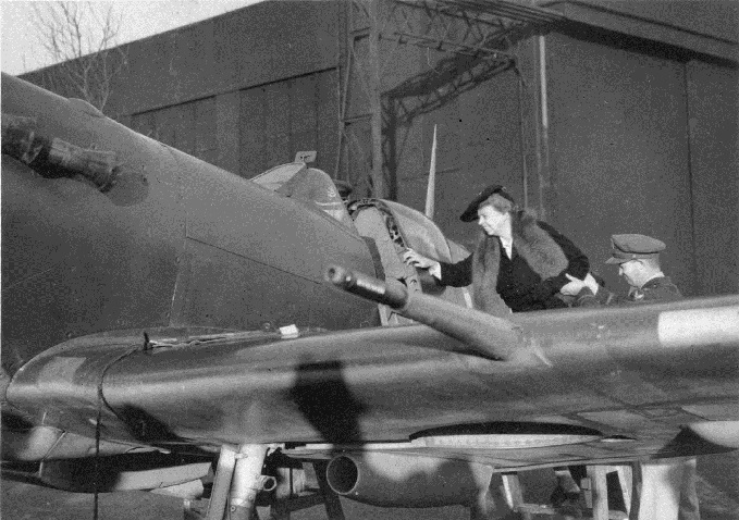 Eleanor Roosevelt being assisted onto the wing of a Spitfire, n.d.