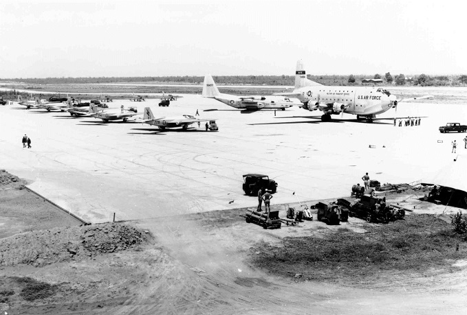 Douglas Globemaster, Military Air Transport Service, taxiing in past Lockheed C-130 Hercules of USAF and English Electric Canberras of RAAF, during Exercise Air Cobra, 1961