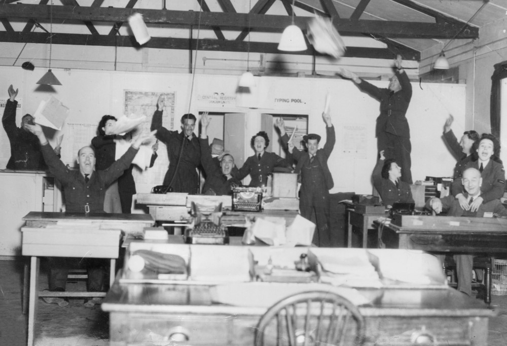 'Staff of the Orderly Room celebrating victory in Europe, RAF Andover'