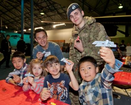 Volunteers and participants posing with thier airfix models