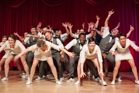 Men and women dancing to swing music