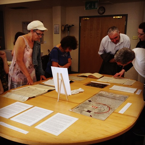 Members of the public viewing original documents from our Archives
