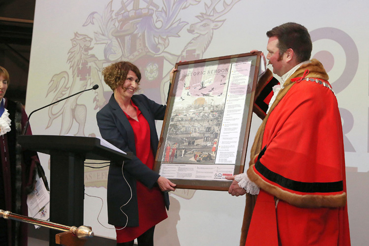 Museum CEO Maggie Appleton presenting the Worshipful Mayor of Barnet, Reuben Thompstone, with a framed copy of our Historic Hendon Poster